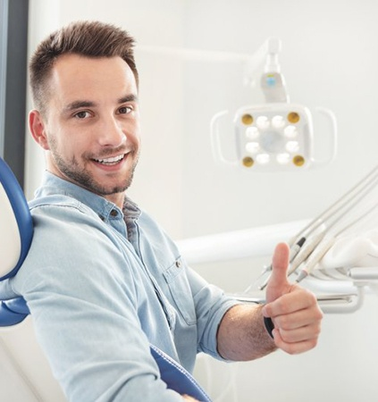 Man with missing tooth looking at tooth shade options