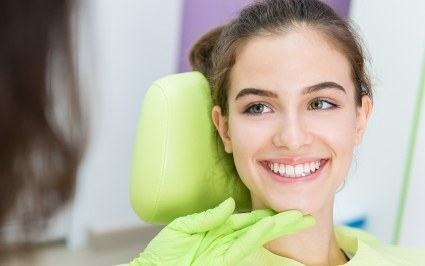Woman smiling during cosmetic dentistry consultation