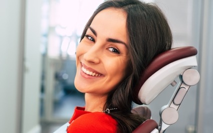 Woman smiling during restorative dentistry appointment